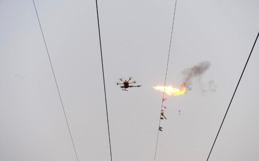 Cleaning power lines is easy when you have a flame-throwing drone0004