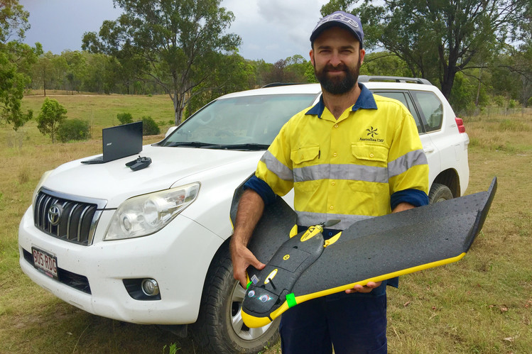 Nick Baranov holds a drone camouflaged with 'eagle-eyes.' Photo: Australian UAV