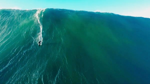 Drone Video Of Surfer Riding Giant Wave In Nazare Portugal