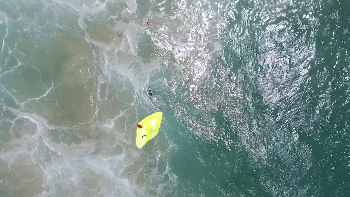 Lifeguards use a drone to rescue to Australian teenagers