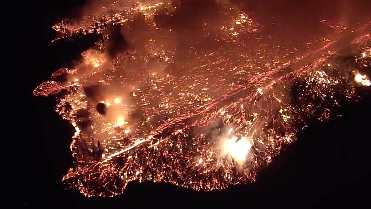 Drone helps guide rescue workers and resident back to safety after successful rescue mission from approaching lava in Kilauea, Hawaii