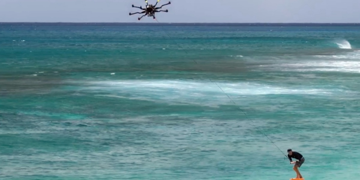 Drone tow-in surfing with a foil board