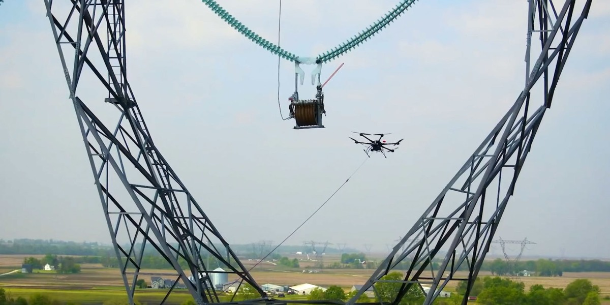 This drone helps workers carry power lines between high towers [Demonstration video]