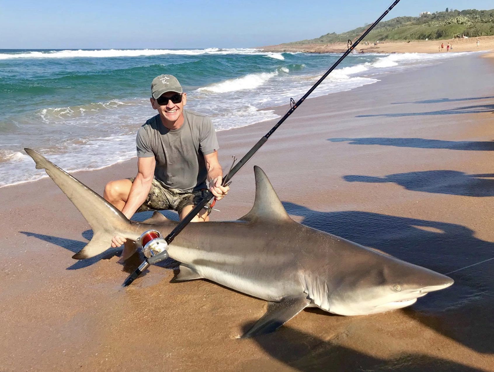 Drone fishermen are catching massive sharks by getting the bait as far as 1,000 feet away from the beach