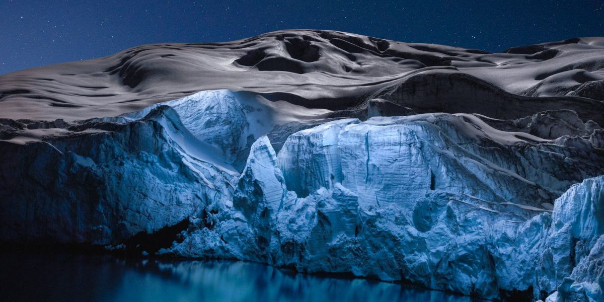 Glaciers dramatically lit up at night by a drone