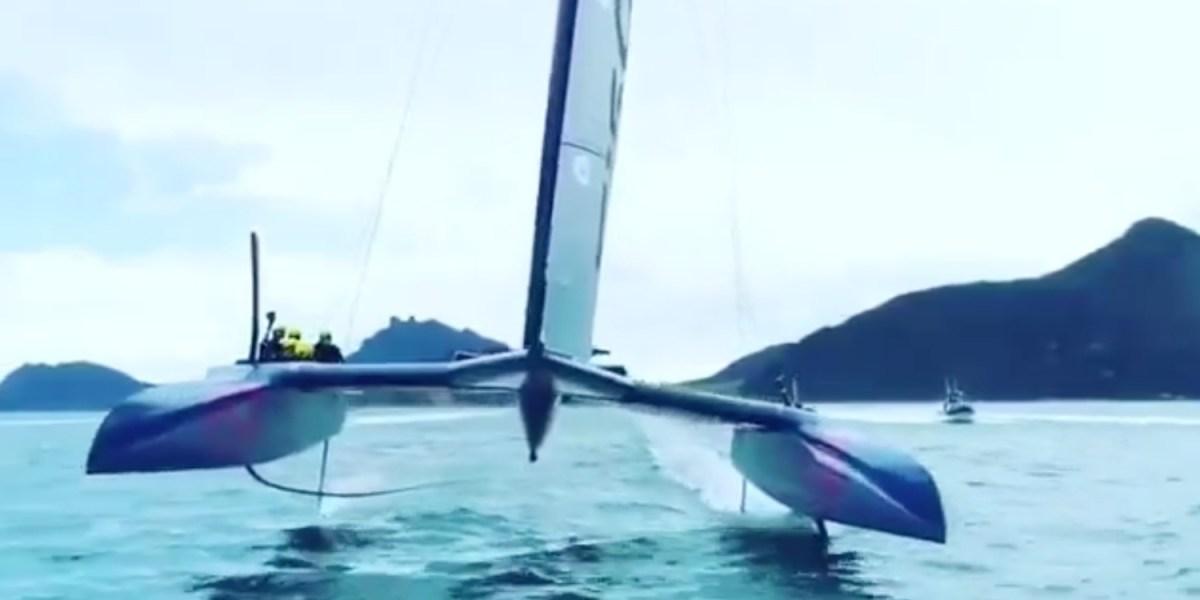 Drone flies underneath USA F50 catamaran [video]