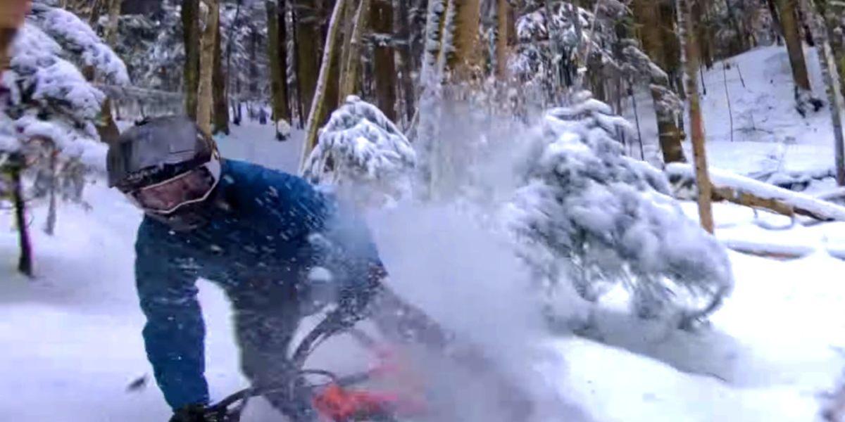 Mountain biker tries to catch FPV race drone
