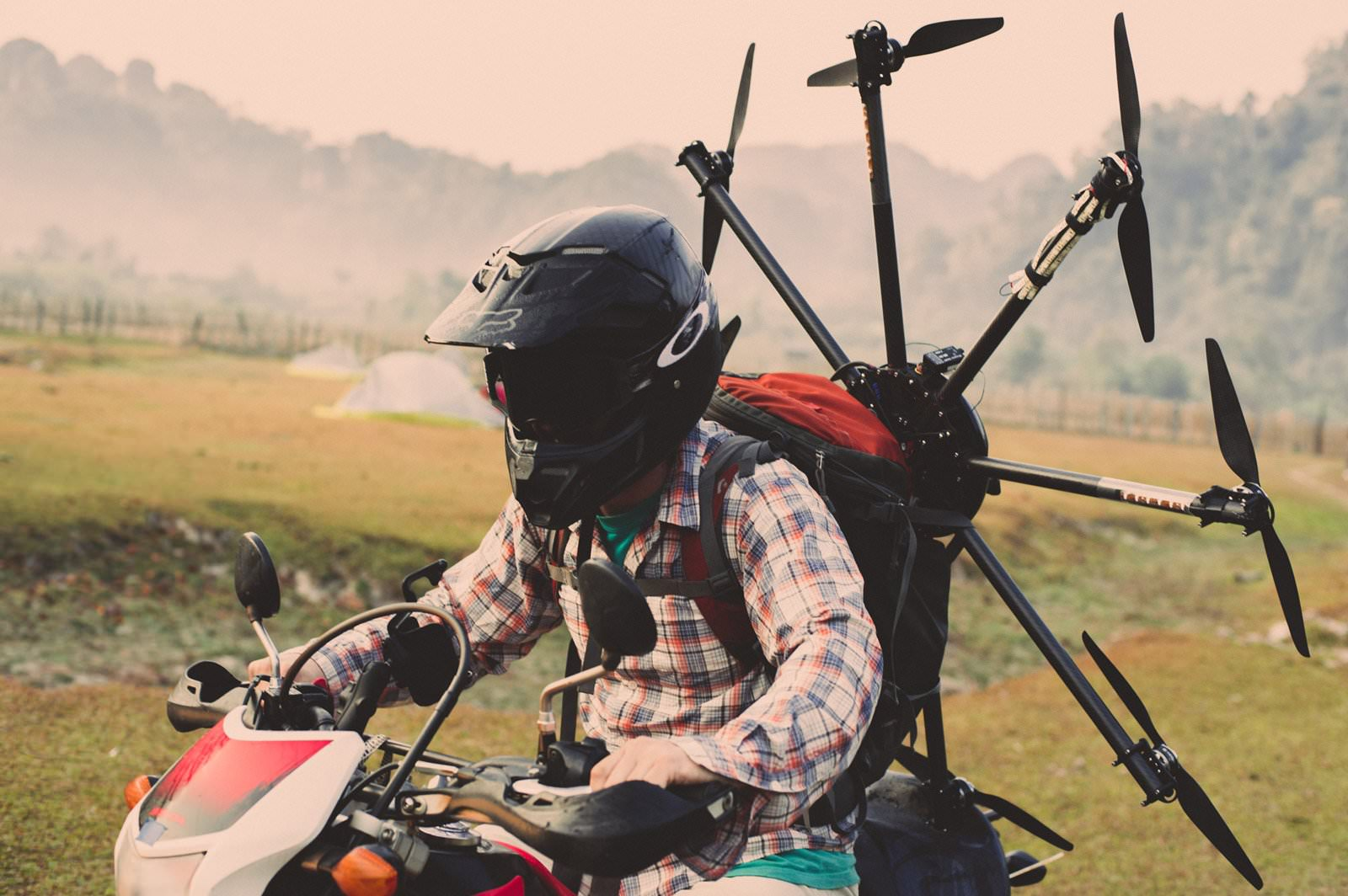 Drone pilot Nick Wolcott transports his drone via motorcycle.