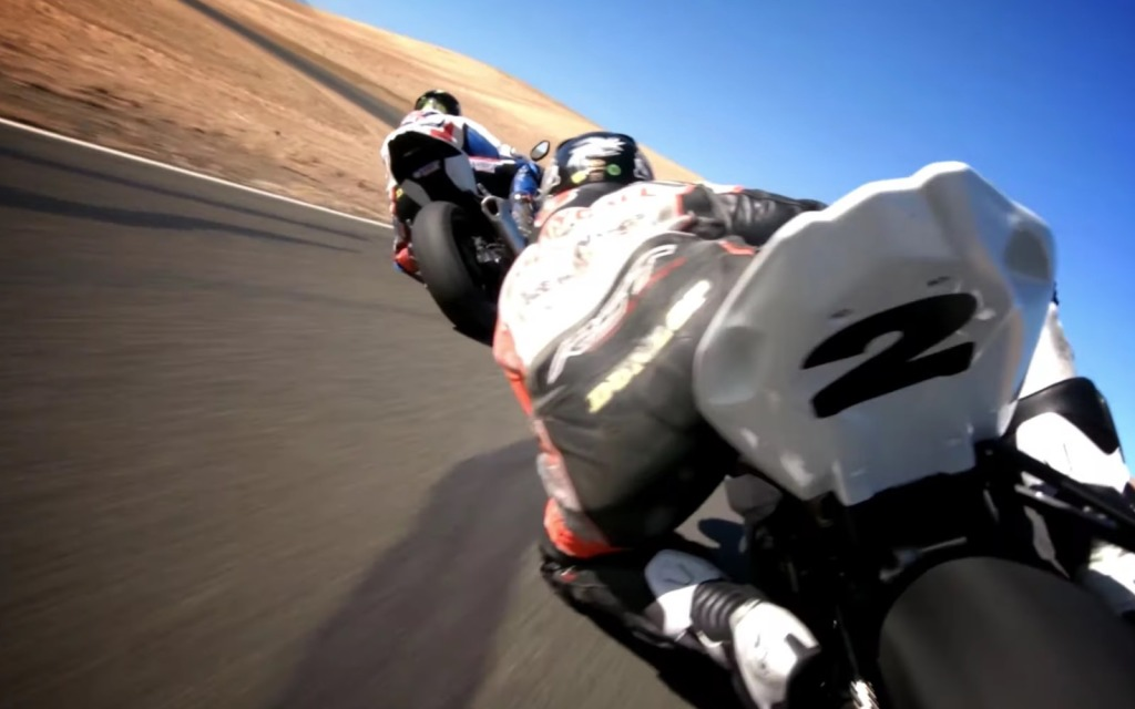 FPV drones race BMW S1000RR motorcycles on track
